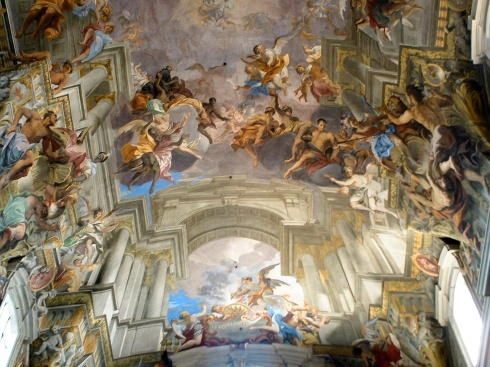 An incredibly detailed painting on the ceiling of a Church in Rome.